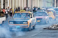 Exhaust Fumes and Taxi in Traffic, Havana, Cuba Stock Photo - Premium Rights-Managednull, Code: 700-06486580