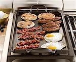 Breakfast cooking on griddle on stove Stock Photo - Premium Royalty-Free, Artist: foodanddrinkphotos, Code: 621-06487927