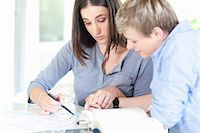 Women working together at desk Stock Photo - Premium Royalty-Freenull, Code: 649-06488421