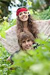 Man carrying girlfriend in tall plants Stock Photo - Premium Royalty-Free, Artist: Ty Milford, Code: 649-06488502