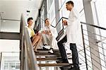 Doctors talking on steps in hospital Stock Photo - Premium Royalty-Free, Artist: Blend Images, Code: 649-06488655
