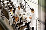 Doctors talking on steps in hospital Stock Photo - Premium Royalty-Free, Artist: Blend Images, Code: 649-06488658