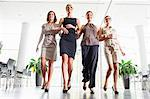 Businesswomen walking in office Stock Photo - Premium Royalty-Free, Artist: Westend61, Code: 649-06488712