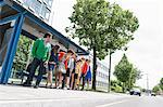 People waiting at bus stops Stock Photo - Premium Royalty-Free, Artist: Blend Images, Code: 649-06488733