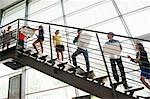 People passing boxes up stairs Stock Photo - Premium Royalty-Free, Artist: Ikon Images, Code: 649-06488736