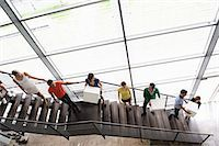 People passing boxes up stairs Stock Photo - Premium Royalty-Freenull, Code: 649-06488773