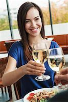 Couple toasting each other at cafe Stock Photo - Premium Royalty-Freenull, Code: 649-06488887