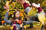 Couple playing in autumn leaves Stock Photo - Premium Royalty-Free, Artist: Blend Images, Code: 649-06488910