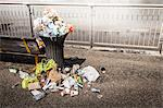 Trash overflowing from bin Stock Photo - Premium Royalty-Free, Artist: Westend61, Code: 649-06488943