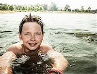preteen swim - Smiling boy swimming in lake Stock Photo - Premium Royalty-Freenull, Code: 649-06488959