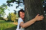 Woman hugging tree in forest Stock Photo - Premium Royalty-Free, Artist: Minden Pictures, Code: 649-06488964