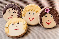sweet   no people - Cookies decorated with faces Stock Photo - Premium Royalty-Freenull, Code: 649-06489013