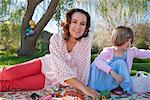 Mother and daughter having picnic Stock Photo - Premium Royalty-Free, Artist: Blend Images, Code: 649-06489022