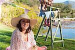 Woman wearing sun hat outdoors Stock Photo - Premium Royalty-Free, Artist: Blend Images, Code: 649-06489031