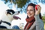 Woman playing fetch with dog Stock Photo - Premium Royalty-Free, Artist: Blend Images, Code: 649-06489054