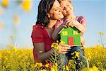 Mother and daughter holding model house Stock Photo - Premium Royalty-Free, Artist: CulturaRM, Code: 649-06489091