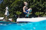 Boy jumping into swimming pool Stock Photo - Premium Royalty-Free, Artist: Cultura RM, Code: 649-06489246