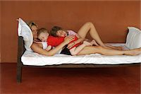Mother and children sleeping on bed Stock Photo - Premium Royalty-Freenull, Code: 649-06489247