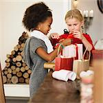 Girls wrapping Christmas presents Stock Photo - Premium Royalty-Free, Artist: Photocuisine, Code: 649-06489274