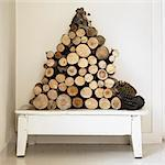 Pile of firewood on bench Stock Photo - Premium Royalty-Free, Artist: Michael Mahovlich, Code: 649-06489277