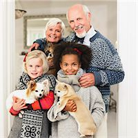 Family posing for Christmas picture Stock Photo - Premium Royalty-Freenull, Code: 649-06489283