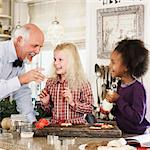 Family baking Christmas cookies together Stock Photo - Premium Royalty-Free, Artist: Blend Images, Code: 649-06489285