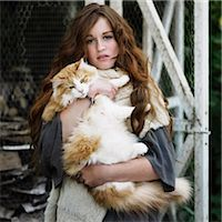 preteen girl pussy - Woman holding large cat outdoors Stock Photo - Premium Royalty-Freenull, Code: 649-06489293