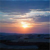 Sun setting over rural landscape Stock Photo - Premium Royalty-Freenull, Code: 649-06489390