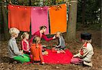 Childrens theater improvised in woods Stock Photo - Premium Royalty-Free, Artist: Robert Harding Images, Code: 649-06489435