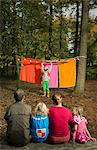 Childrens theater improvised in woods Stock Photo - Premium Royalty-Free, Artist: Blend Images, Code: 649-06489438