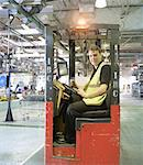 Apprentice lift operator in car factory Stock Photo - Premium Royalty-Free, Artist: Cultura RM, Code: 649-06489480
