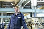 Apprentice standing in car factory Stock Photo - Premium Royalty-Free, Artist: Uwe Umsttter, Code: 649-06489492