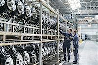Workers inspecting axles in car factory Stock Photo - Premium Royalty-Freenull, Code: 649-06489495