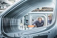 Apprentices inspecting car in factory Stock Photo - Premium Royalty-Freenull, Code: 649-06489497