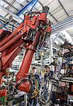 Apprentices with robots in car factory Stock Photo - Premium Royalty-Free, Artist: Blend Images, Code: 649-06489510