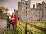 Older couple reading map by castle Stock Photo - Premium Royalty-Free, Artist: ableimages, Code: 649-06489540