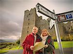 Older couple reading map on rural road Stock Photo - Premium Royalty-Freenull, Code: 649-06489543