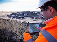 Ecologist examining surface coal mine Stock Photo - Premium Royalty-Freenull, Code: 649-06489574