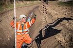 Worker directing digger in surface mine Stock Photo - Premium Royalty-Free, Artist: Minden Pictures, Code: 649-06489585