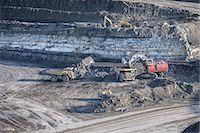 Trucks and digger at surface coal mine Stock Photo - Premium Royalty-Freenull, Code: 649-06489603