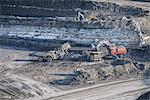 Trucks and digger at surface coal mine Stock Photo - Premium Royalty-Free, Artist: Westend61, Code: 649-06489603