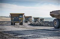 Trucks with coal rocks at surface mine Stock Photo - Premium Royalty-Freenull, Code: 649-06489606