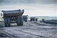 Trucks with coal rocks at surface mine Stock Photo - Premium Royalty-Freenull, Code: 649-06489610