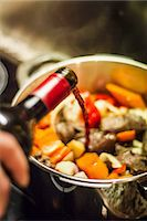 spicy - Man pouring wine into vegetables Stock Photo - Premium Royalty-Freenull, Code: 649-06489670
