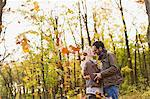 Smiling couple kissing in forest Stock Photo - Premium Royalty-Free, Artist: Robert Harding Images, Code: 649-06489783