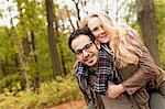 Man carrying girlfriend in forest Stock Photo - Premium Royalty-Free, Artist: Jim Craigmyle, Code: 649-06489786
