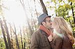 Smiling couple kissing in forest Stock Photo - Premium Royalty-Free, Artist: Uwe Umsttter, Code: 649-06489792