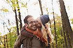 Smiling couple kissing in forest Stock Photo - Premium Royalty-Free, Artist: Jim Craigmyle, Code: 649-06489795