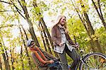 Couple riding bicycle in forest Stock Photo - Premium Royalty-Free, Artist: Blend Images, Code: 649-06489804