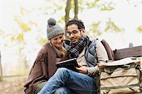 people sitting on bench - Couple using tablet computer in park Stock Photo - Premium Royalty-Freenull, Code: 649-06489837